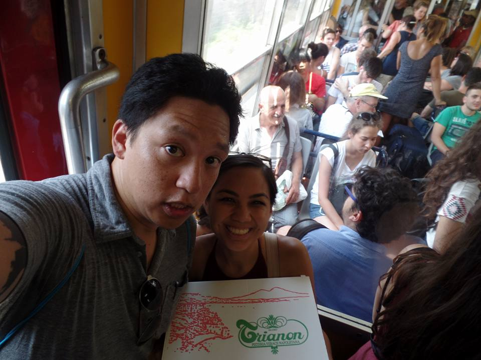 Holding our leftover pizza on our hot, crowded Circumvesuviana train