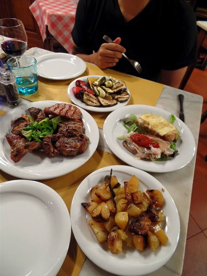 Soft rosemary potatoes, a grilled meat plate, honey brie bruschetta, prosciutto pomodoro bruschetta, and grilled vegetables