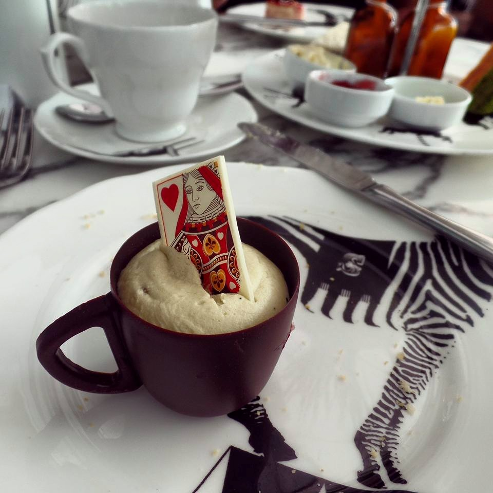 Matcha white chocolate mousse in an edible chocolate teacup