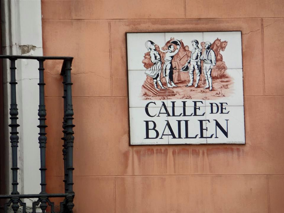 Streets in Madrid have signs with graphics on the buildings. This is the dancing street, obviously.